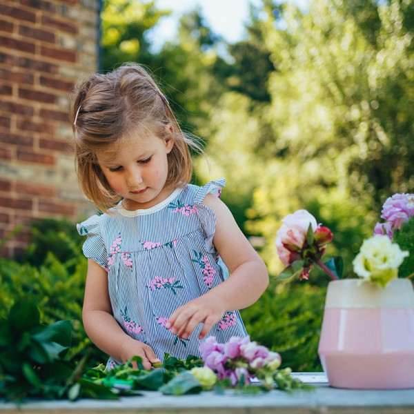 Young girl flower arranging activity subscription box