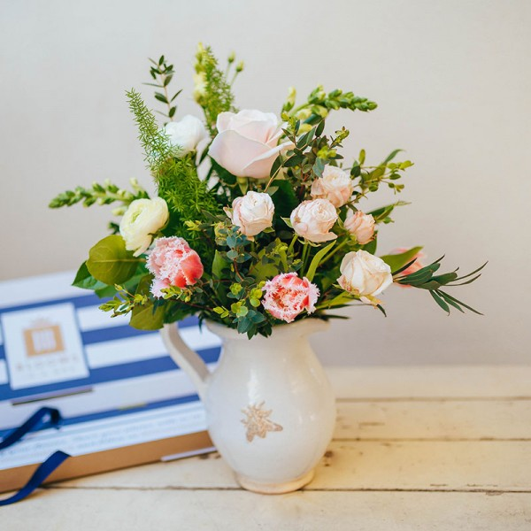Blooms in a Box letterbox flower arrangement with roses and tulips