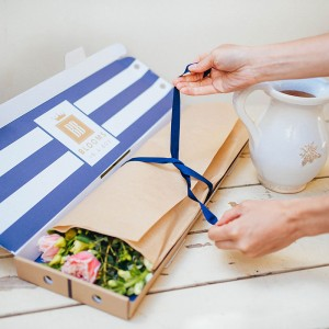 Untying the ribbon for Blooms in a Box Letterbox flowers delivery