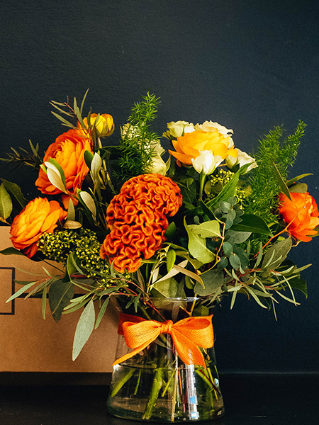 Blooms in a Box arrangement of corals and orange colours fresh vibrant