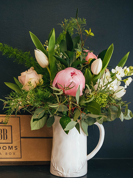 Blooms in a Box arrangement of tulips, roses, peonies and stocks