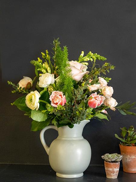Blooms in a Box arrangement of tulips, roses, ranunculus